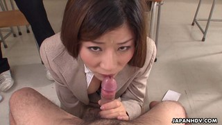 Horny teacher sucking off her students
