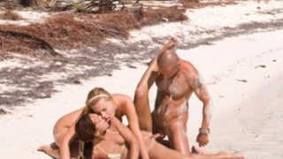 Sandy beach threesome