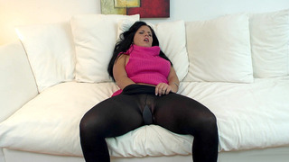 Missy Maze slides her hand into her stockings and starts masturbating