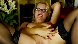 Blonde mature woman fingering her pussy