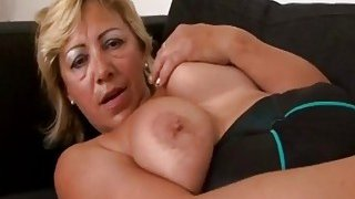 A hot big tit blonde granny masturbates before black stud drills her wet vagina