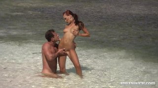 Slutty bitch Claudia Adams fucks on the beach